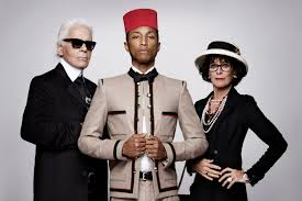 Karl Lagerfeld, Pharrell Williams (in the jacket that inspired Coco Chanel, and Geraldine Chaplin who played Coco Chanel. (Photo Credit: Google Images.)